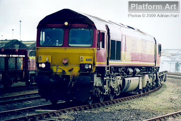 EWS Class 66 locomotive 66151 is seen at Eastleigh near Southampton with a short rake of flats on 13th February 2006.