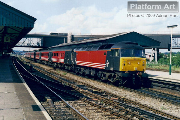 With matching rolling stock, Virgin Cross Country liveried Class 47 47818 waits at Reading on 20th August 1999, with a service from Manchester Piccadilly to London Paddington.