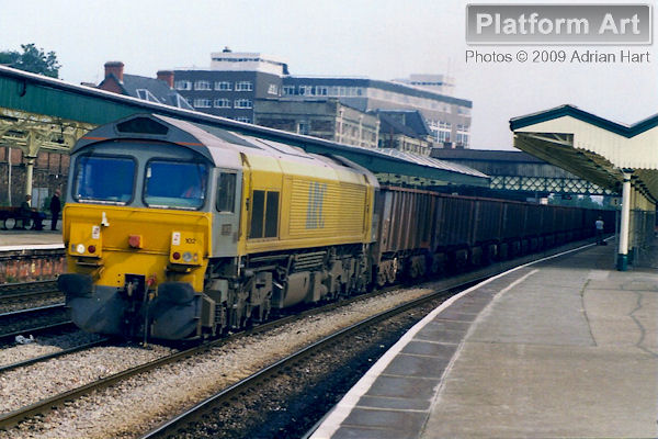On hire from Mendip Rail to EWS, ARC liveried Class 59 locomotive 59102 is seen passing Newport in South Wales with empty iron-ore tipplers from Llanwern steelworks on 22nd September 1998.