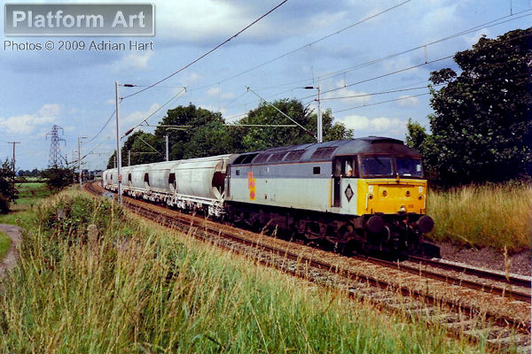 Class 47 47312 approaches Gailey near Penkridge on 22nd July 1992 with the 6V70 Cliffe Vale - Exeter Speedlink service. The train is returning empty china clay slurry tanks from the Potteries to Cornwall.