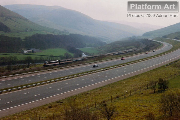 Inter City Class 90 locomotive 90009 hauls the 11.14 Manchester Piccadilly - Edinburgh service through the Lune Gorge south of Tebay on 1st April 1989.