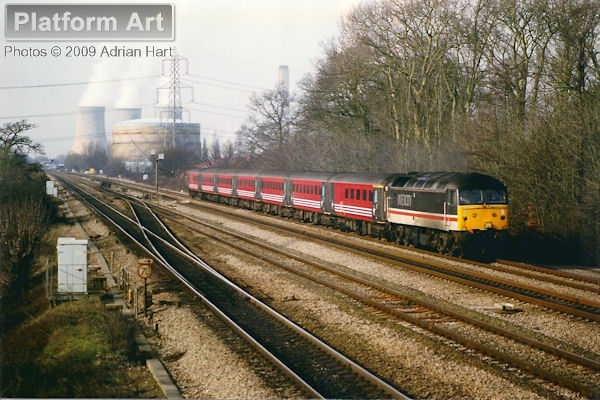 Inter City liveried Class 47 47827 heads a rake of Virgin Cross Country stock east of Didcot on 3rd February 1998, with the 09.17 Manchester Piccadilly to London Paddington service.