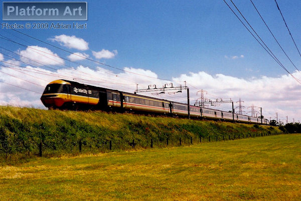 HST power cars 43182 and 43146 speed north at Brinsford between Wolverhampton and Stafford, on the afternoon of 8th July 1990.