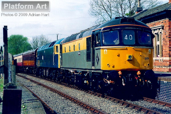 Class 33 33019 Griffon and Class 47 47244 arrive at Shenton on the Battlefields Line on 30th April 2005 with a service from Shackerstone. The station building at Shenton came from Humberstone Road in Leicester.
