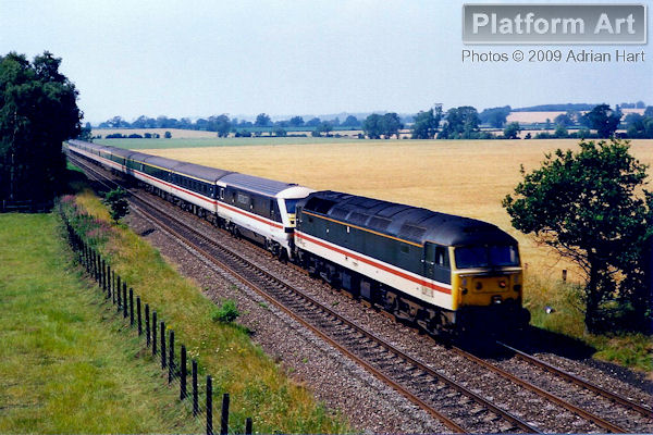 Class 47 locomotive 47483 leads DVT 82135 past Bonemill Bridge between Shifnal and Cosford on 16th July 1990, with the 14.29 Shrewsbury - London Euston service.