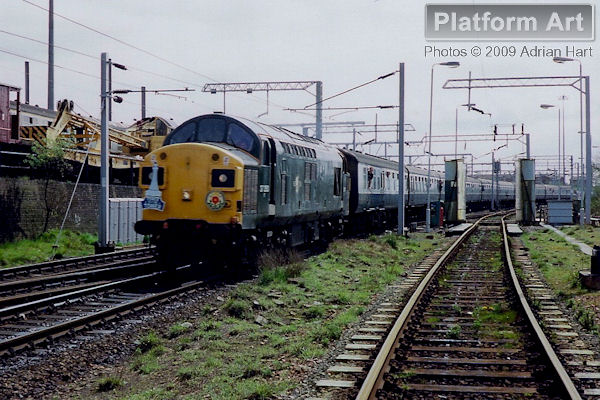 On 1st May 1989, the Class 20 Association ran the Power to the Tower railtour from Sheffield to Blackpool via Shrewsbury. The train is seen passing Oxley Carriage Sidings near Wolverhampton on the outward journey behind green liveried Class 37 37350.