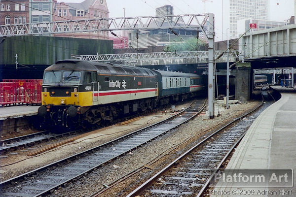 Class 47 47611 Thames arrives at Birmingham New Street with a morning Poole - Liverpool Lime Street service on 22nd April 1989.