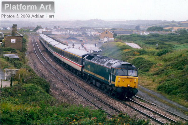 First Great Western Class 47 47811 passes a rainy Marazion with the 12.55 Penzance - London Paddington service on 15th August 2000.