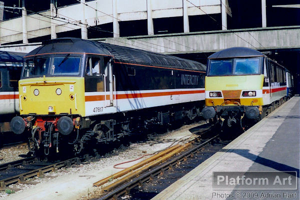 Inter City Mainline liveried Class 47 47817 and Class 90 90035 are seen at Birmingham New Street on the afternoon of July 17th 1990.