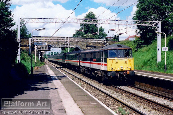 Class 86 86210 City of Edinburgh speeds through Adlington between Stockport and Macclesfield on 16th July 1991 with the 14.20 Manchester Piccadilly - Poole service.
