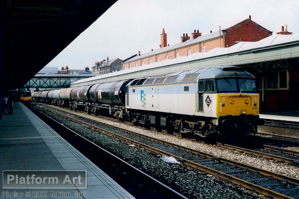 In Railfreight Petroleum livery, Class 47 47336 powers the 6E50 09.45 Langley - Lindsey oil train through Nottingham on 30th July 1990.