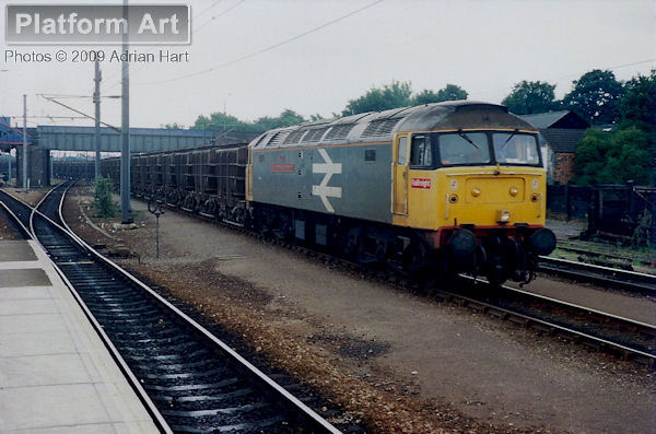 Class 47 47348 St Christophers Railway Home arrives at Peterborough with the 6M46 15.35 Fletton - Ratcliffe-on-Soar Power Station flyash empties on 10th August 1989.