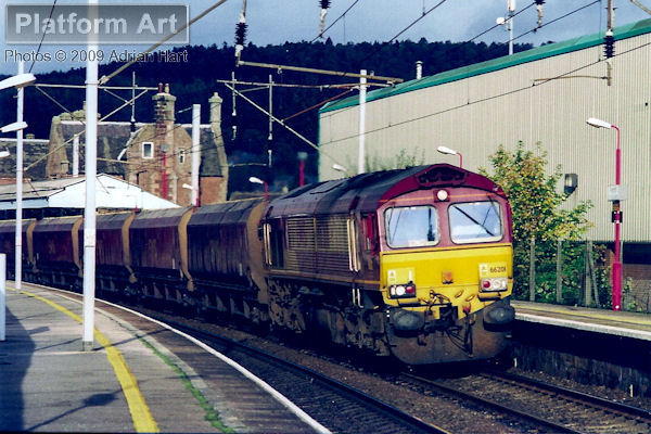 EWS Class 66 locomotive 66201 passes Penrith in October 2005 with a southbound coal train from Scotland.