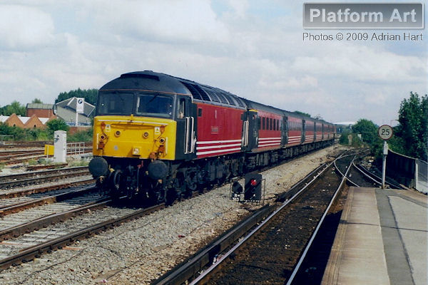 Virgin Trains liveried Class 47 47702 County of Suffolk approaches Reading with a London Paddington - Glasgow service on 20th August 1999.