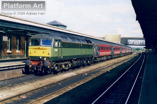 Resplendent in two-tone green livery, Class 47 47488 waits at Reading on 20th August 1999 with a southbound Virgin Cross Country service from Manchester Piccadilly to Bournemouth.