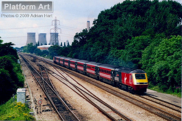 Virgin Cross Country HST power car 43153 The English Riviera Torquay-Paignton-Brixham is seen leading a southbound service between Didcot and South Moreton on 6th July 2002.