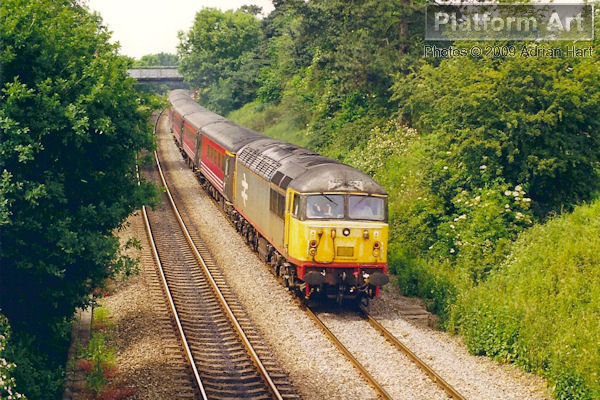 Due to a lack of available Class 47 locomotives, Railfreight liveried Class 56 56019 was rostered for a Bournemouth bound Virgin Cross Country service on the afternoon of 20th June 1998, seen approaching Kings Sutton. The Class 56 retraced its steps later that day with the 18.14 Bournemouth - Manchester Piccadilly service.