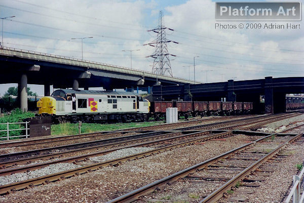 Speedlink liveried Class 37 37055 is seen reversing a train of mineral wagons out of Washwood Heath yard on 17th July 1989, before heading west towards Birmingham.