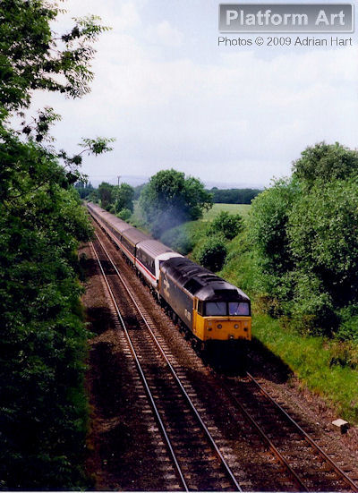 Class 47 locomotive 47456 hauls DVT 82125 through the beautiful Shropshire countryside near Albrighton on 21st June 1991, with the 14.29 Shrewsbury - London Euston service.